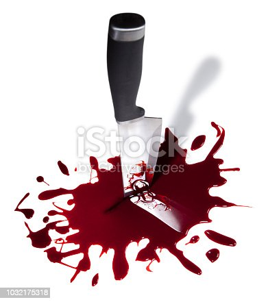 This is a color photograph with no people of a new kitchen knife in the middle of a pile of blood. The background is a pure white and there is a clipping path included with this stock photo.