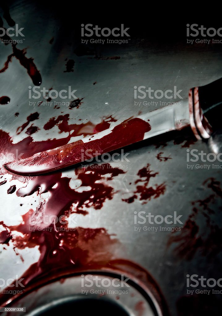 Bloody knife in sink stock photo