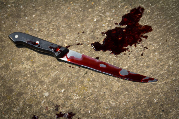 Bloody knife on the floor stock photo