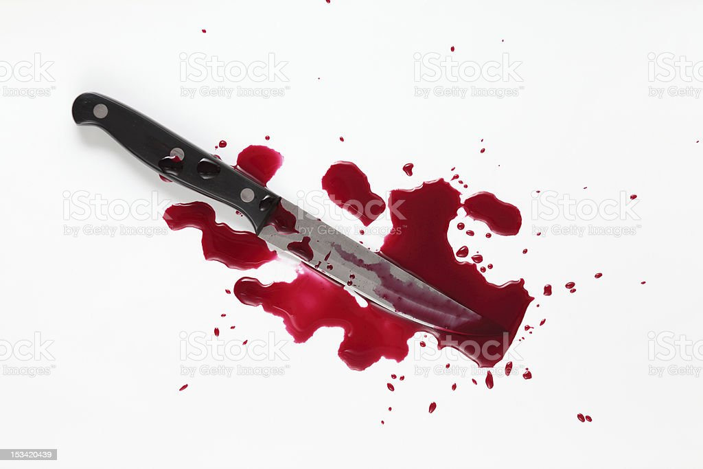 Bloody knife with blood splatter isolated on white. stock photo