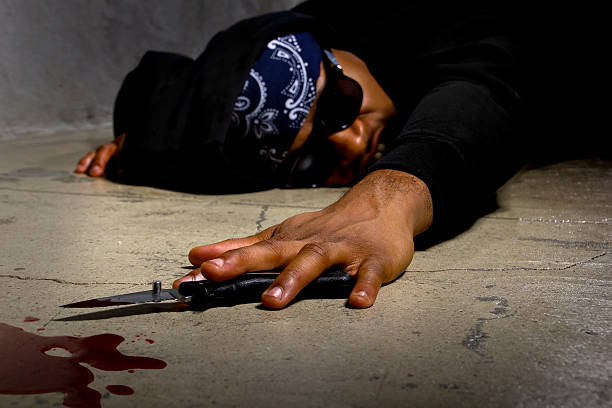 Bloody Male Victim Stabbed in an Alley stock photo