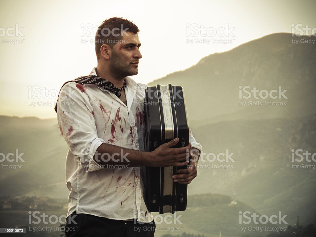 Bloody man looking proudly with briefcase stock photo