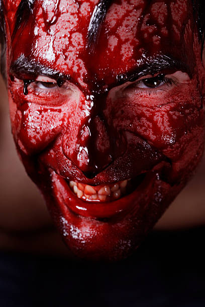 Bloody man smiling stock photo
