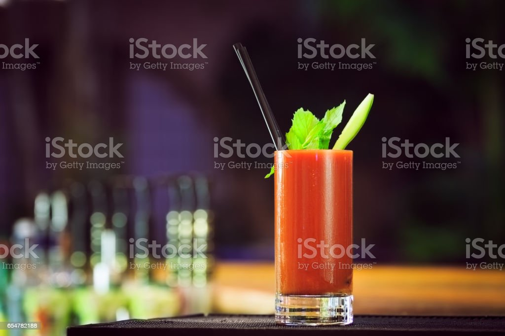 Bloody Mary at the bar counter. Classic cocktail. stock photo