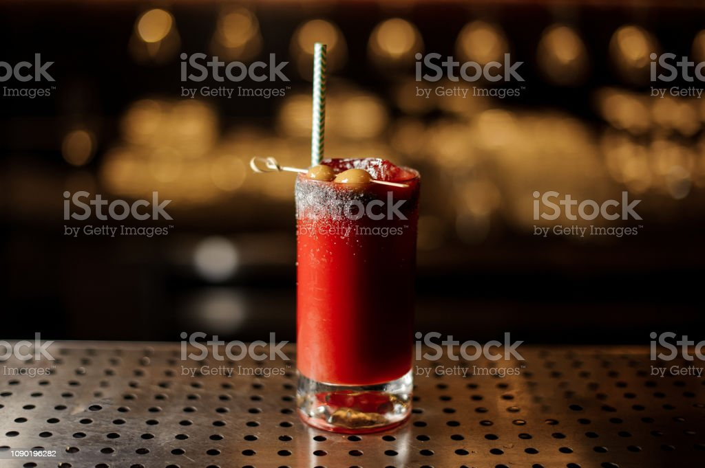 Bloody Mary cocktail in the decorative glass with olives and tubule stock photo