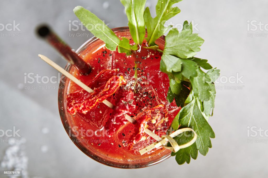 Bloody Mary Cocktail over Gray Background Bloody Mary Cocktail over Gray Background Above Stock Photo