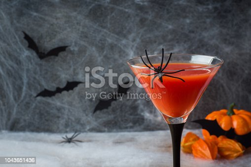 istock Bloody Mary cocktail, pumpkin with bats and spiders for Halloween, selective focus 1043651436