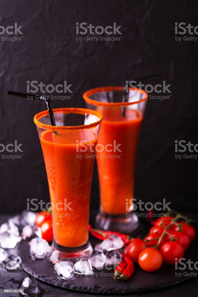 Bloody Mary cocktail with chili pepper, ice and celery. stock photo