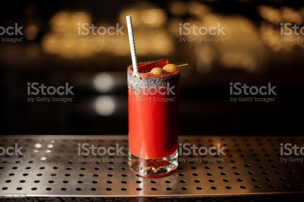 Bloody Mary cocktail with tubule in the decorative glass stock photo