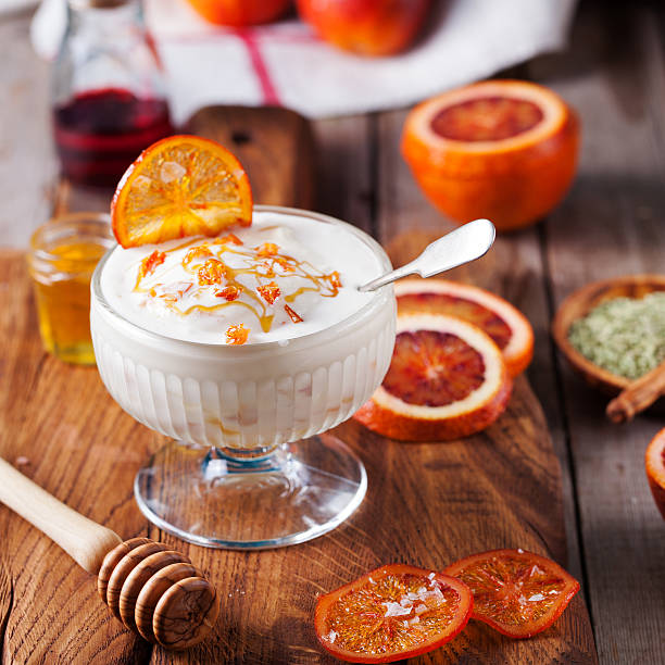 bloody oranges dessert, ice cream in a glass bowl - zitronen quark dessert stock-fotos und bilder