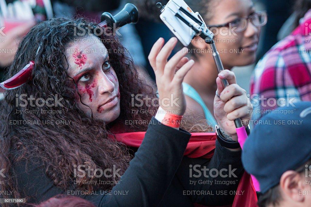 Bloody Woman Takes Selfie At Georgia Zombie Festival stock photo