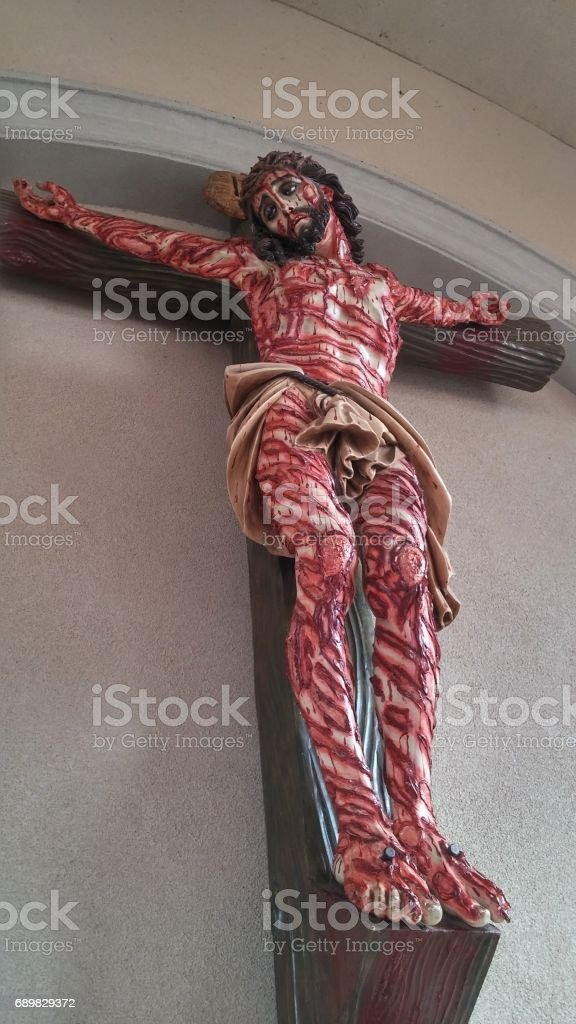 Bloody Wounds Crucified Jesus Cross Statue stock photo
