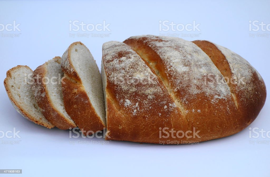 bloomer, a crusty sliced loaf of lovely homemade bread stock photo