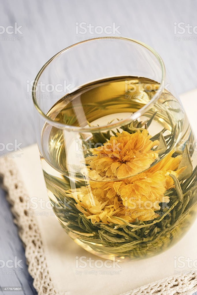 Blooming Flower Tea in Glass stock photo