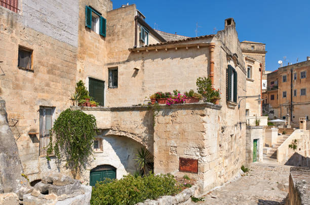 Blooming flowers in ancient Sassi neighborhood, Matera, Basilicata, Italy. Cultural Capital of Europe 2019 stock photo