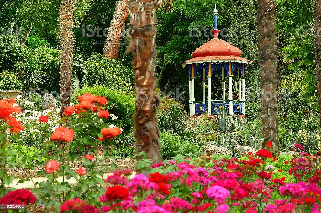 blooming summer garden and gazebo stock photo