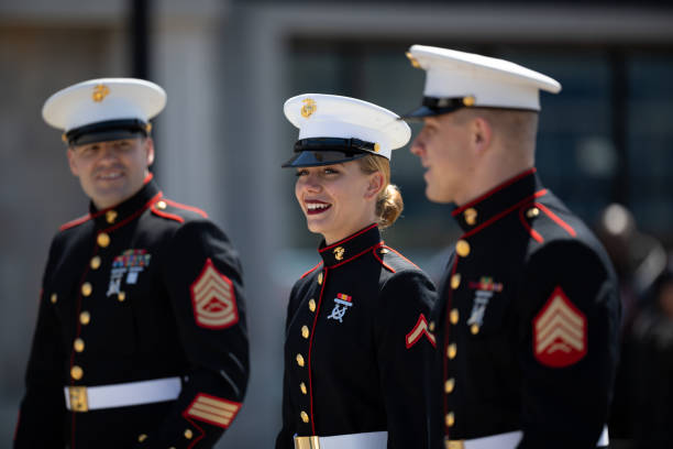 Blossomtime Festival Grand Floral Parade Benton Harbor, Michigan, USA - May 4, 2019: Blossomtime Festival Grand Floral Parade, Members of the United States Marine Corps walking down the street during the parade marines military stock pictures, royalty-free photos & images