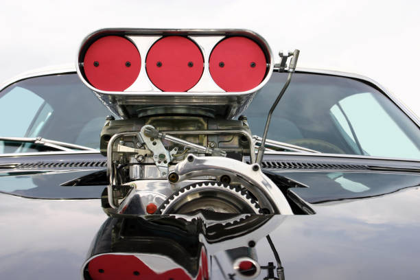 Blower on the mask of classic muscle car Shot on the blower on the mask of classic muscle car. carburetor stock pictures, royalty-free photos & images
