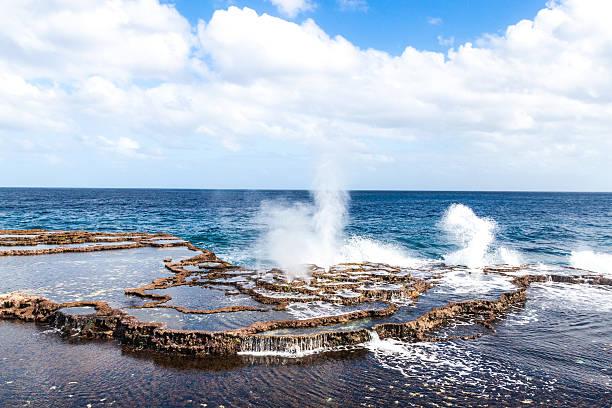 Blowholes on a coast of Tongatapu island, Tonga stock photo