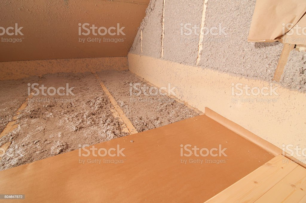 Blow-in cellulose fiber wool insulation stock photo