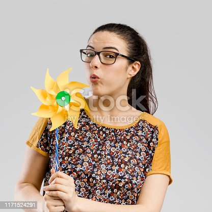 istock Blowing a windmill 1171524291
