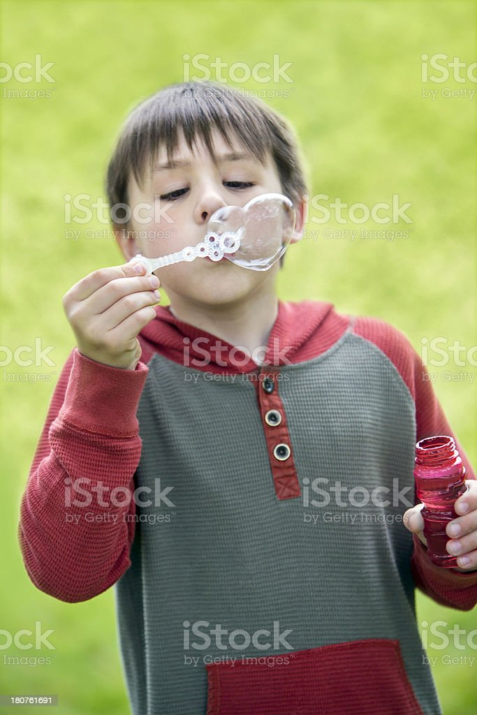 Blowing Bubbles Hearts royalty-free stock photo