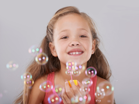 Blowing Bubbles Stock Photo - Download Image Now