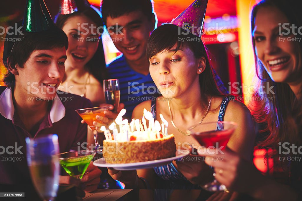 Blowing candles stock photo