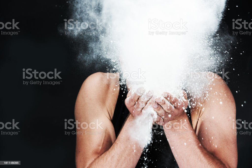Blowing cocaine Studio shot of a young man blowing powder into the air 20-24 Years Stock Photo
