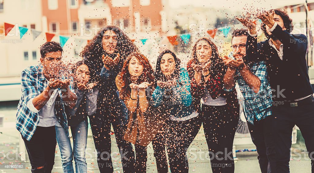 Blowing Confetti At Party stock photo