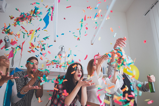 Blowing Confetti On Party - Fotografias de stock e mais imagens de Abraçar