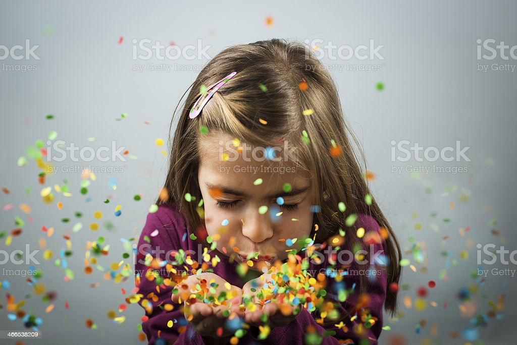 Blowing confetti stock photo