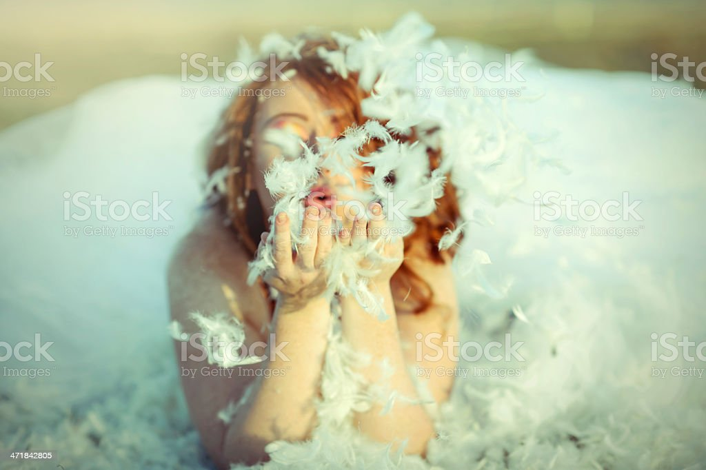 blowing feathers royalty-free stock photo