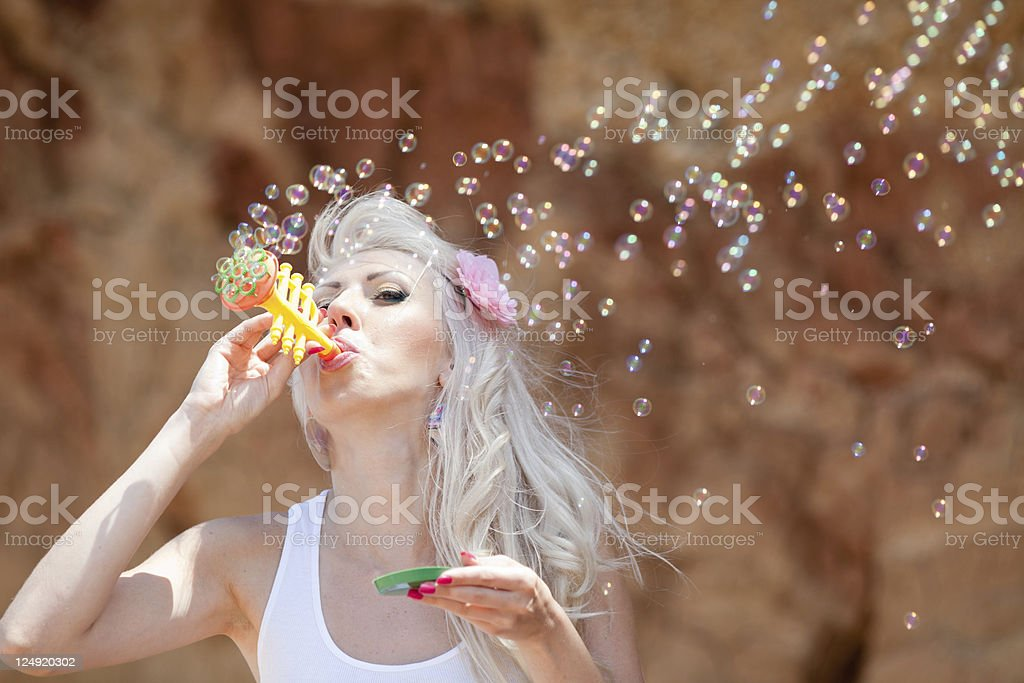 Blowing girl on open air stock photo