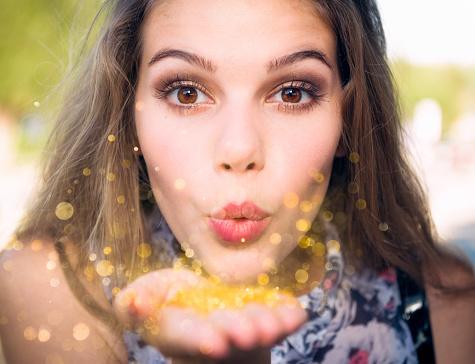 istock Blowing golden sparkles 502187774