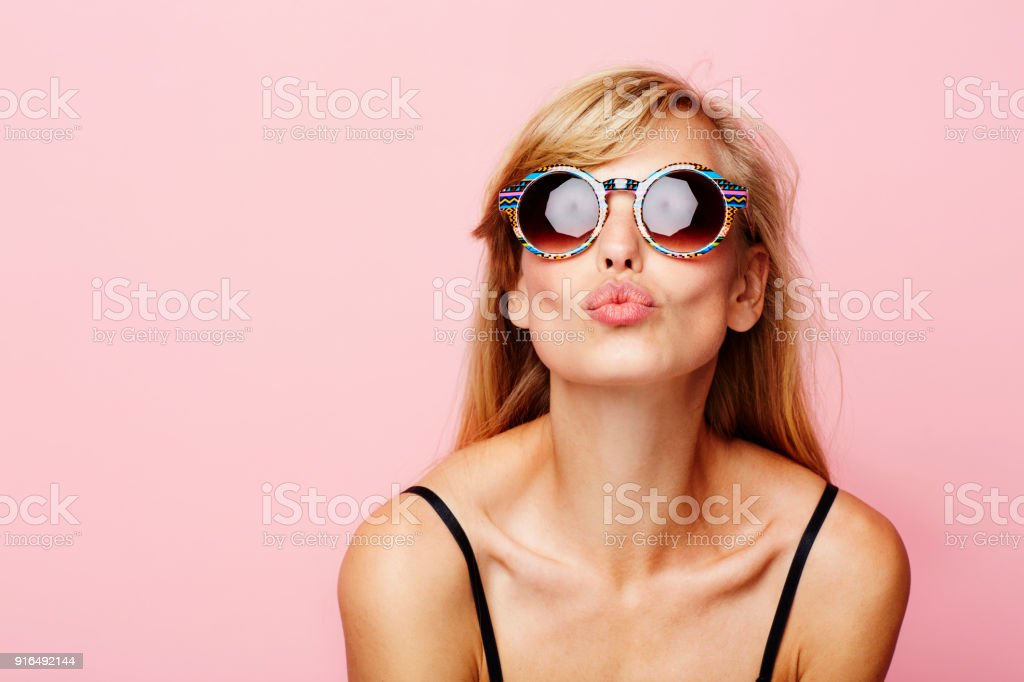 Blowing kiss babe stock photo