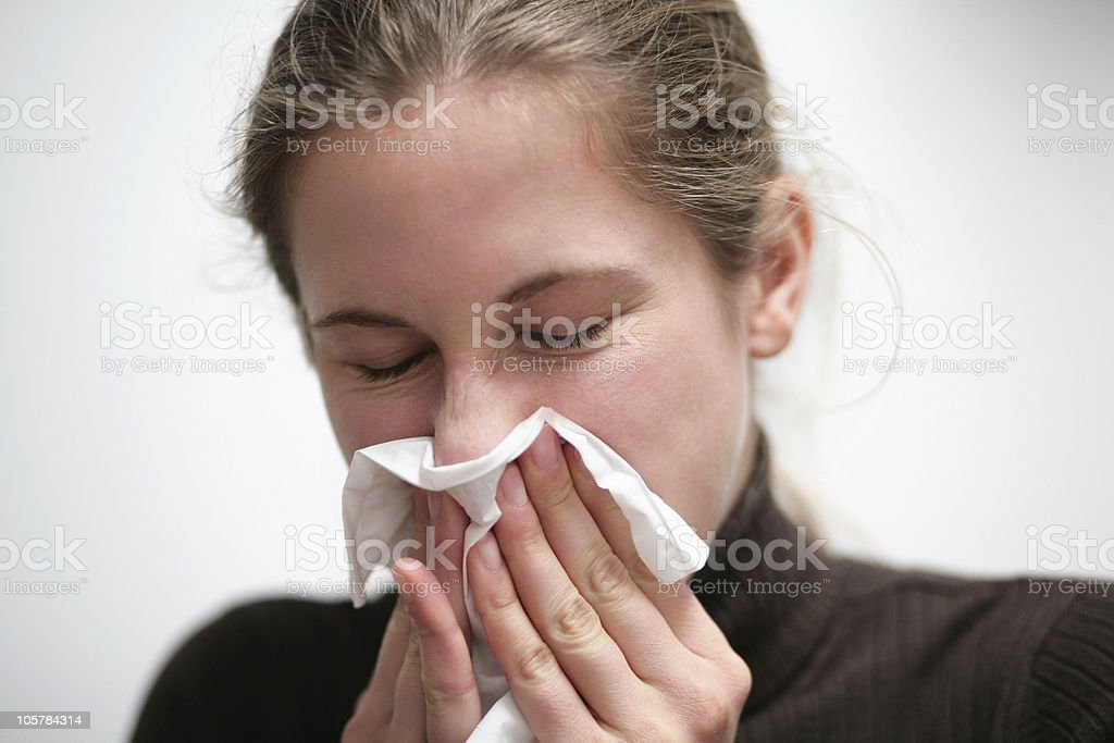 blowing nose royalty-free stock photo