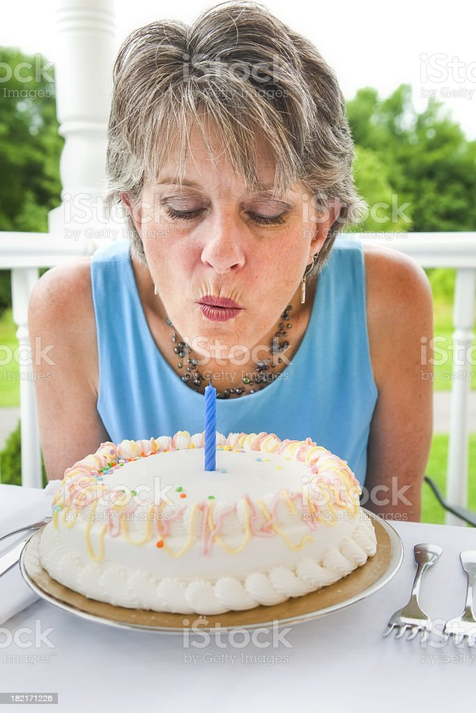 Blowing out the candle royalty-free stock photo