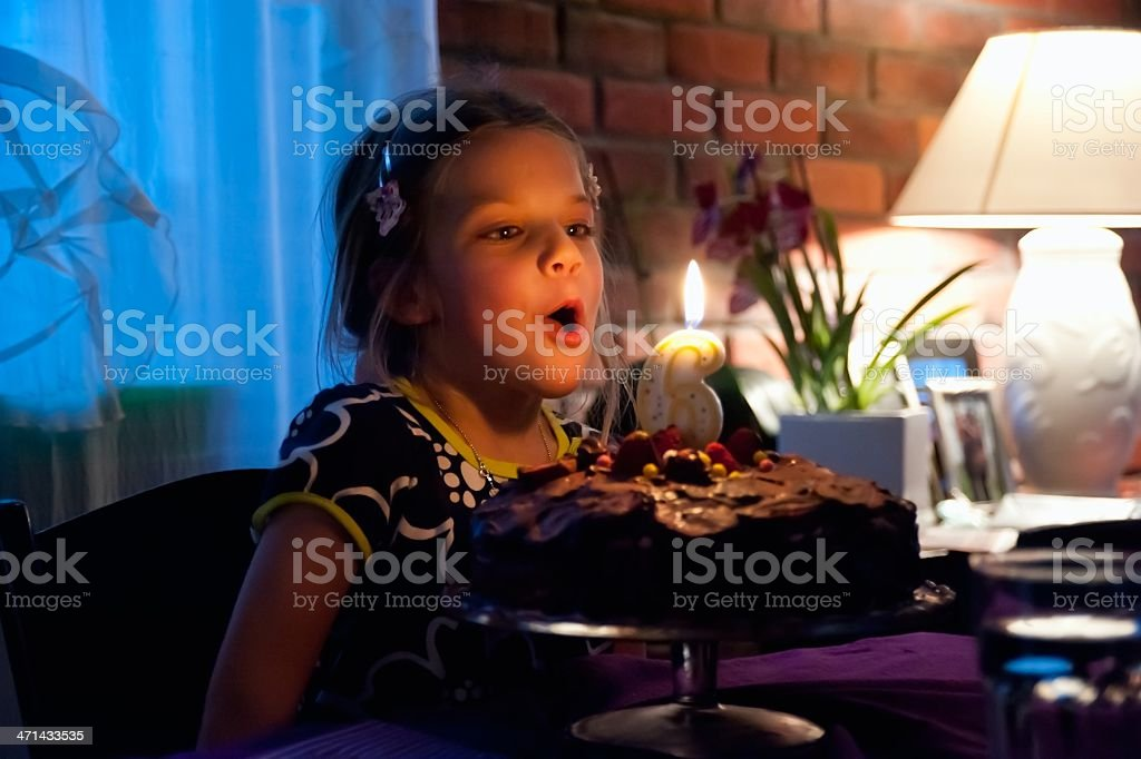 Blowing out the Candle stock photo