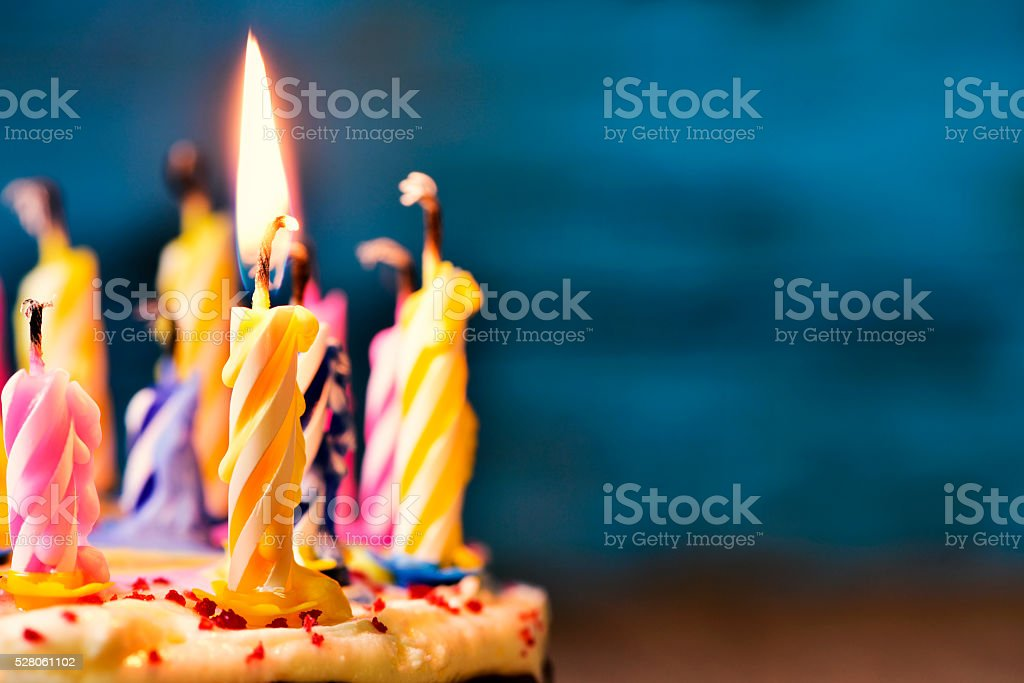 blowing out the candles of a cake stock photo