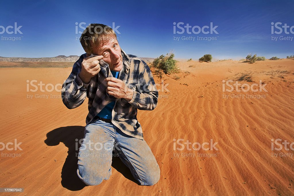 Blowing Sand in the Eyes. stock photo