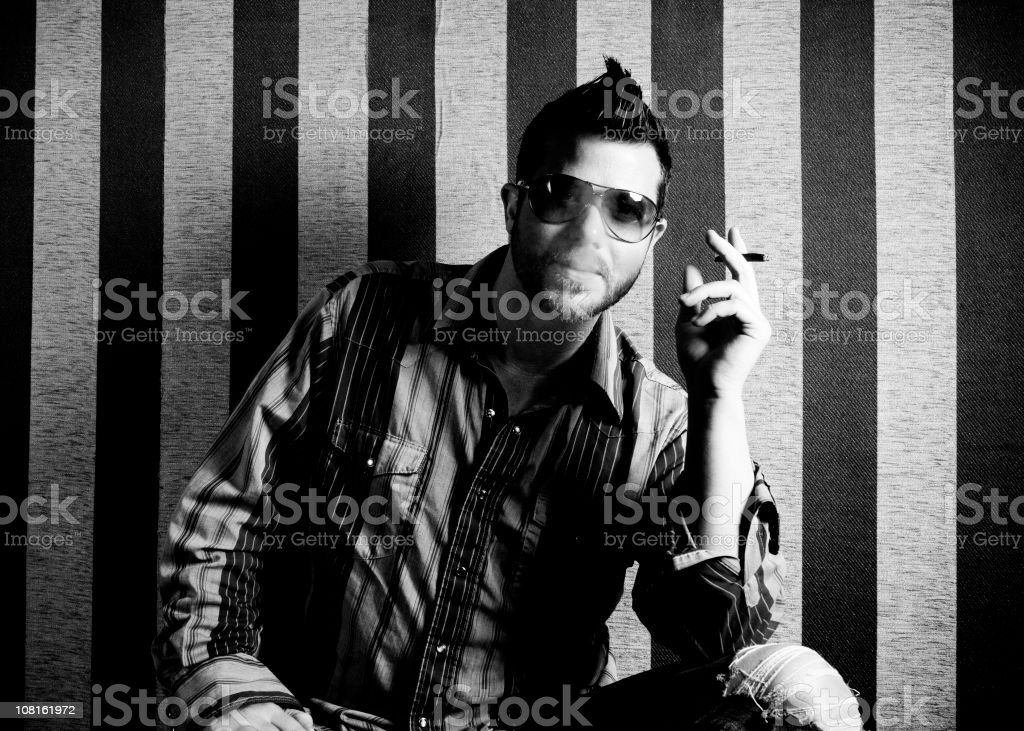 Blowing Smoke royalty-free stock photo