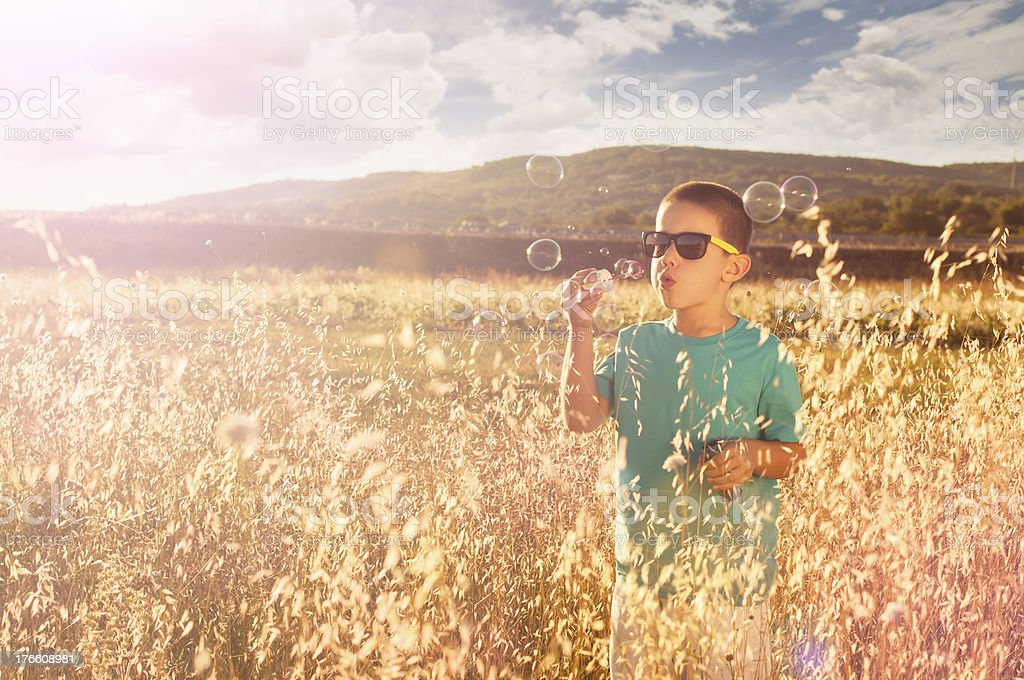 Blowing soap bubbles royalty-free stock photo