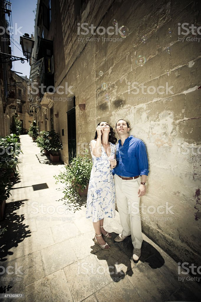 Blowing Soap Bubbles Playful Mature Couple royalty-free stock photo
