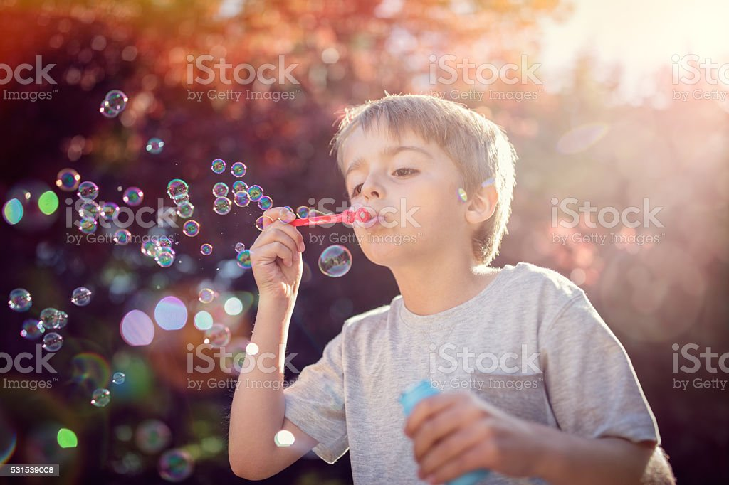 Blowing summer soap bubbles stock photo