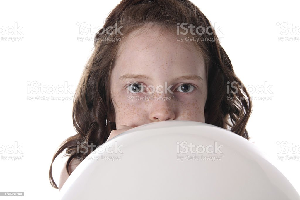 Blowing Up a Balloon royalty-free stock photo