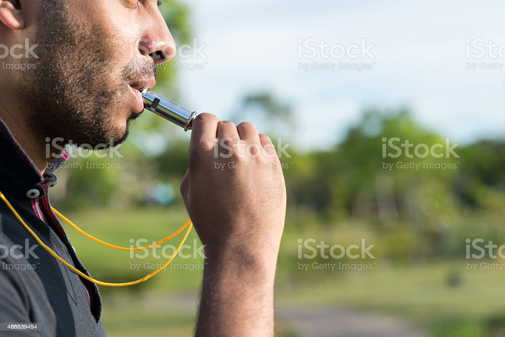Blowing whistle stock photo