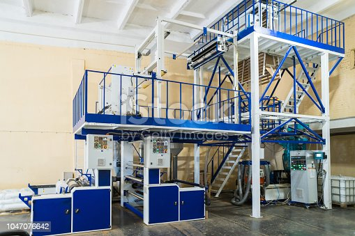 istock Blown film extrusion plastic bag making machine 1047076642