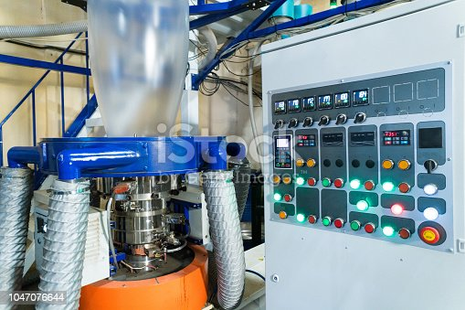 istock Blown film extrusion plastic bag making machine 1047076644