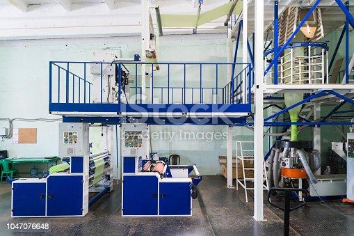 istock Blown film extrusion plastic bag making machine 1047076648